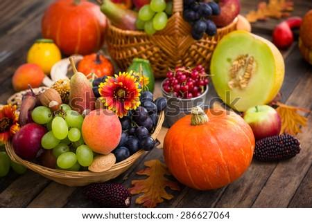 Autumn fruits on the table - stock photo