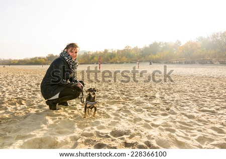 Autumn fun with dog on the sea beach