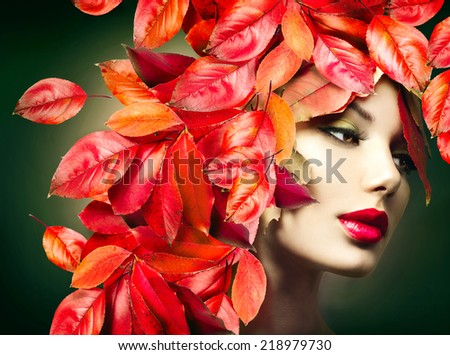 Autumn Girl Fashion Portrait. Fall. Beautiful Model woman with colourful autumn leaves hairstyle. Red Autumn leaves Hair. Fashion Art design - stock photo