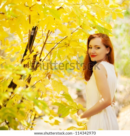 Autumn girl playing in city park. Fall woman portrait of happy lovely and beautiful mixed race - stock photo