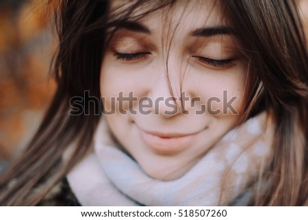 autumn girl with close eyes