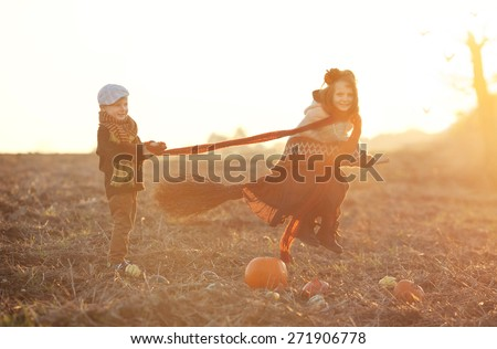 Autumn, Halloween- fun in flying on a broomstick