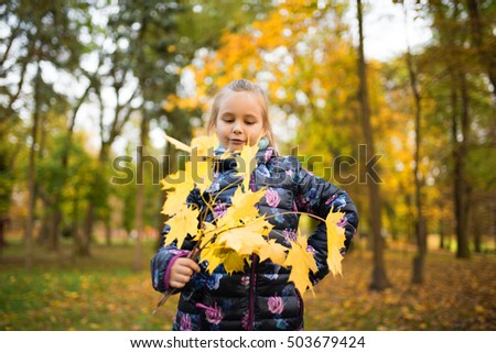 autumn happy little girl