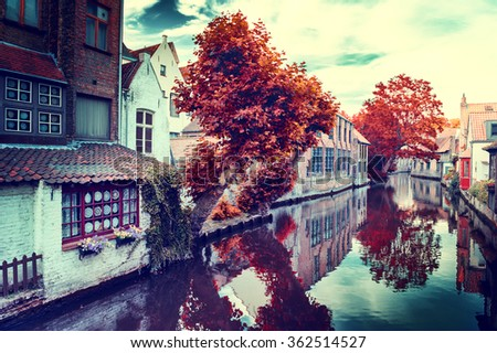 Autumn in Bruges. Cityscape with historic medieval houses along canal