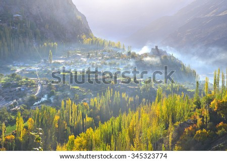 autumn in Hunza valley with backlight  and mist in the morning time  - stock photo