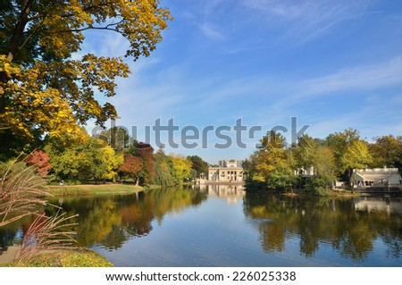Autumn in Lazienki Park. View over the lake on Royal Palace. South facade of the building. - stock photo