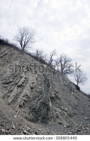 Autumn in mountain. Grey clouds - stock photo