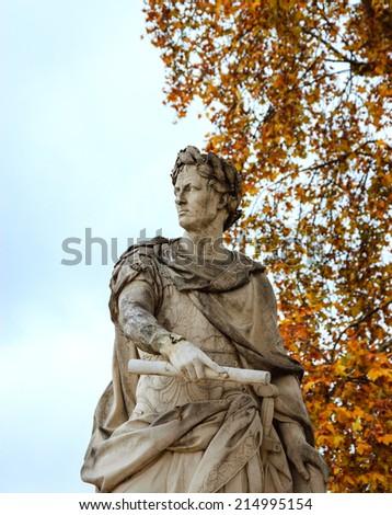 Autumn in Paris. Julius Caesar marble statue in Tuileries gardens. - stock photo
