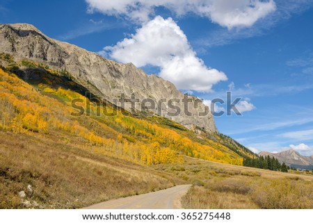 Autumn in Rockies - Autumn view of Rocky Mountains and aspen groves at Gothic Mountain in West Elk Mountains range of the Colorado Rockies, near Crested Butte, Colorado, USA. - stock photo