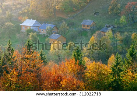 Autumn in the mountain village. Seasonal landscape. Carpathians, Ukraine, Europe - stock photo
