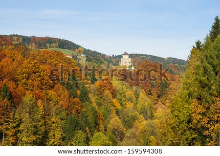 Autumn in Upper Austria with colorful trees and ruins of the castle in the background