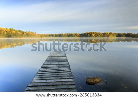 Autumn Lake Forest Reflections With Wooden Bridge In North Poland/ Sunrise Lake At Autumn - stock photo