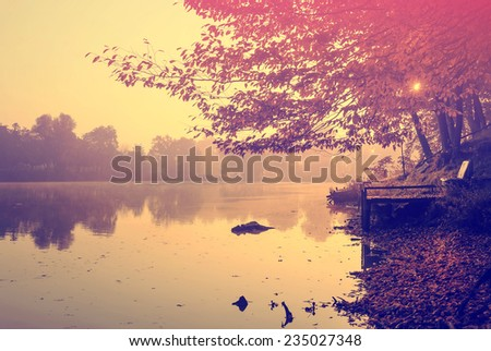 Autumn lake in morning lights - stock photo