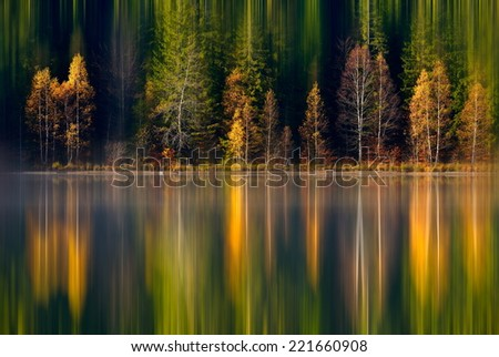 autumn landscape and its reflection in mountain lake - stock photo