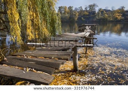 Autumn landscape and wooden foot bridge in Zaporozhye. Ukraine - stock photo