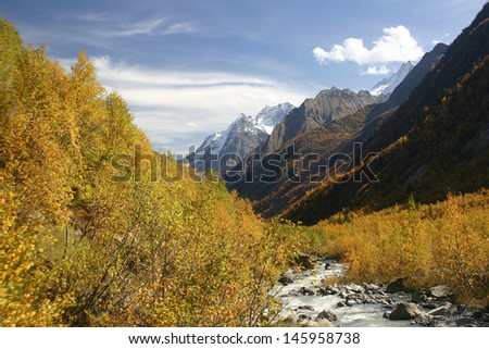 Autumn landscape in the mountains with a river - stock photo