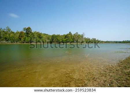 autumn landscape - lake and autumnal forest. - stock photo