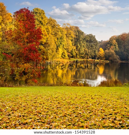 Autumn Landscape. Park in Autumn. The bright colors of autumn in the park by the lake. - stock photo