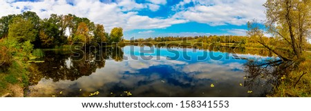 Autumn Landscape. Park in Autumn. The bright colors of autumn in the park by the lake. Panorama