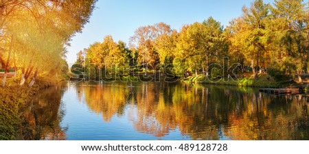 Autumn landscape, the bright rays of the sun. The multicolored leaves.
