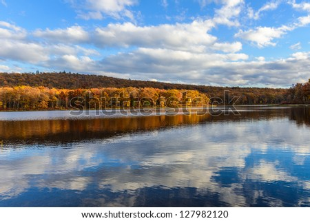 Autumn landscape with a reflection in the lake - stock photo