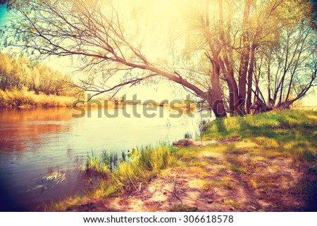 Autumn landscape with a river. Beautiful autumnal scene, fall - stock photo