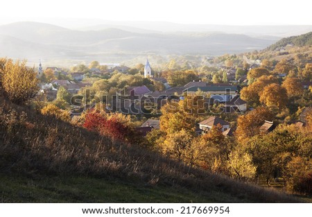 Autumn landscape with church in the village  - stock photo