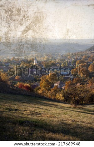 Autumn landscape with church in the village - vintage photo - stock photo