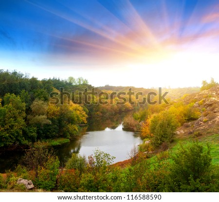 Autumn landscape with river in evening time - stock photo