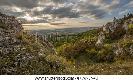 Autumn landscape with rocks and cloudy sky