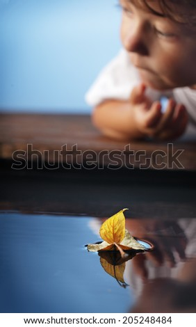 autumn leaf  ship and children  (focus on ship) - stock photo