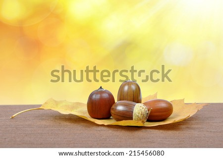 Autumn leaf with oak acorns - stock photo