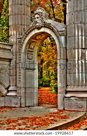 Autumn leaves and stone arch - stock photo