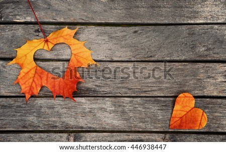 Autumn leaves. Autumn leaves heart. Autumn leaves on wood background. Color autumn leaves. Autumn hearts for love. Autumn leaves on wood. Autumn leaves background. Autumn wood background.