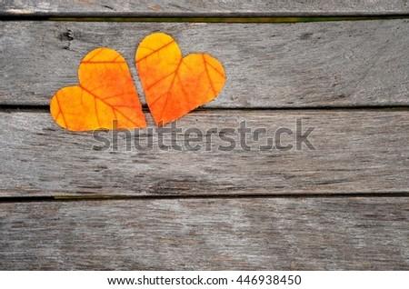 Autumn leaves. Autumn leaves heart. Autumn leaves on wood background. Color autumn leaves. Autumn hearts for love. Autumn leaves on wood. Autumn leaves background. Autumn wood background.  - stock photo