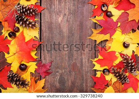 Autumn leaves on a board background - stock photo