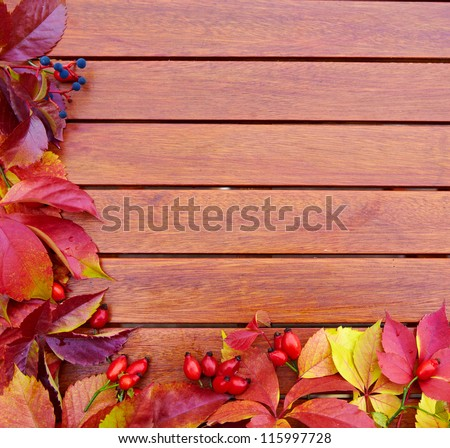 Autumn Leaves over wooden backgound - stock photo