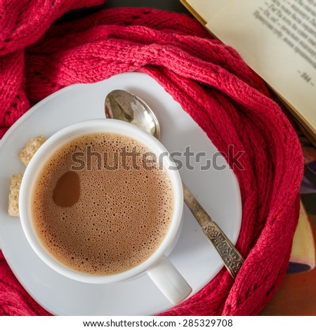 Autumn lifestyle - hot chocolate, old book, tray, warm blanket, rustic wood background, top view - stock photo