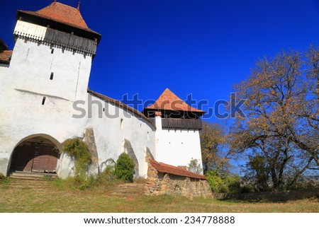 Autumn light on fortified church from UNESCO world heritage list in Viscri village, Transylvania, Romania - stock photo