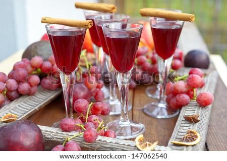 Autumn liqueur, grain, plum and spices - stock photo