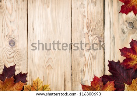 Autumn maple leaves on wooden background with copy space. Top view - stock photo