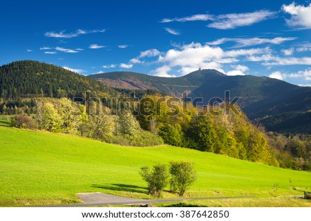 Autumn meadow in mountain landscape with clear blue sky and Lysa hora summit - Moravian-Silesian Beskydy - stock photo