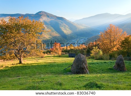 Autumn misty evening mountain hill with stack of hay  (Rahiv town outskirts, Carpathian Mt's, Ukraine). - stock photo