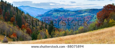 Autumn misty morning mountain panorama with haystack in front (Carpathian Mt's, Ukraine). Two shots stitch image. - stock photo