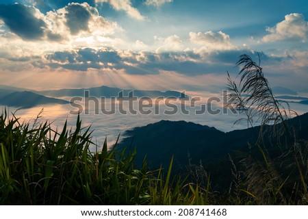 Autumn morning mountain view with sunbeam and haze at Doi Pha Tang, chiang rai - stock photo