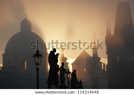 Autumn morning - Statues on Charles Bridge, Prague, Czech Republic - stock photo