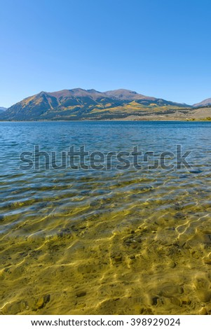 Autumn Mountain Lake - Autumn view of crystal clear Twin Lakes Reservoir, at the foot of Mount Elbert, 14,440 ft (4,400 m), along the headwaters of Arkansas River, near Leadville, Colorado, USA. - stock photo