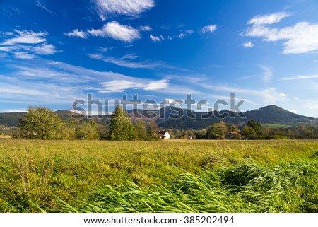 Autumn mountain landscape with small clouds on perfect blue sky - Moravian-Silesian Beskydy