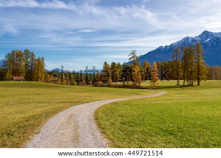 Autumn mountain scenery in the Alps with hiking trail. Mieminger plateau, Austria, Tyrol.