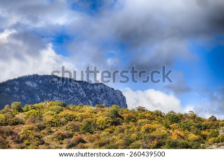 Autumn mountain slope and cliff scenic in Crimea - stock photo